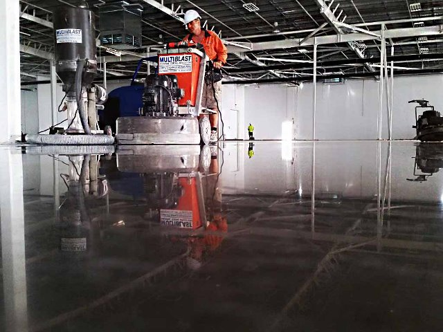 Concrete being polished by commercial concrete polishing experts Brisbane