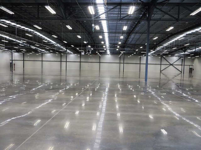 Polished concrete inside warehouse by Multiblast industrial flooring Gold Coast